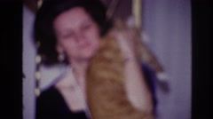 1967: woman playing and dancing with her cat. OTTAWA CANADA Stock Footage