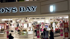 People taking video from escalator of Hudson's Bay store Stock Footage