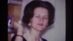 1967: lady wearing necklace standing kitchen working husband cigarette smoking Stock Footage
