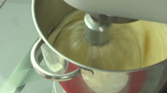 Whipping cream or egg whites in metal bowl with electric mixer machine Stock Footage