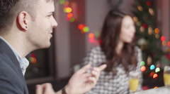 Caucasion man talking to Japanese frineds at International christmas party  Stock Footage