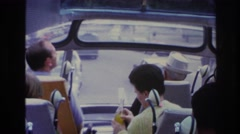 1967: woman on tour bus drinking orange soda PARIS FRANCE Stock Footage