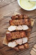 Skewered meat or shish kebabs of pork in marinade Stock Photos