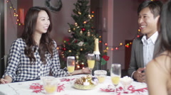 Handsome Japanese man gives christmas present to women at Dinner party  Stock Footage