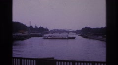 1967: driving by the lake, watching the boat stay afloat. PARIS FRANCE Stock Footage
