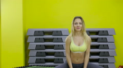 Classic bodybuilding. Muscular blonde fitness woman doing exercises in the gym Stock Footage