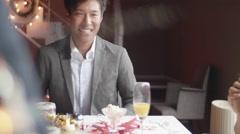 International women recieving christmas gift from handsom Japanese man  Stock Footage