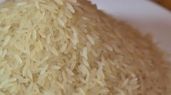 Footage of rice on a plate, the shot is moving in a half circle Stock Footage