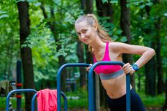 Young slim woman doing workout in a training ground Kuvituskuvat