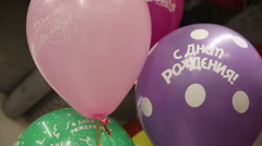 Ballons with russian words Happy Birthday Stock Footage