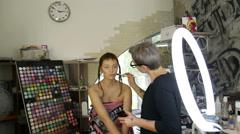 Stylist evens skin tone model Stock Footage