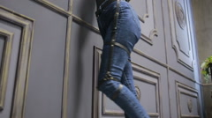 Girl in jeans with leather garter new fashion trends. straps on the hips Stock Footage