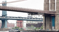 East River Ferry Under Brooklyn and Manhattan Bridges Stock Footage