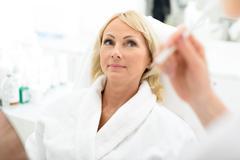 Senior lady getting treatment at wellness center Kuvituskuvat