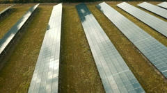 Solar panel farm, sustainable energy concept. Aerial footage Stock Footage