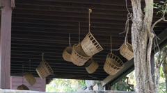 Wicker baskets hang from the ceiling and spin in the breeze. Cambodia Stock Footage