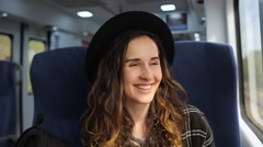 Girl rides on the train and smiling Stock Footage
