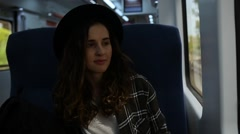 Girl in hat rides on the train Stock Footage