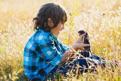 Teenage happy boy playing with rat pet outdoor Stock Photos