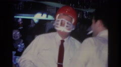 1966: a man in a bar wearing an orange football helmet HOBOKEN NEW JERSEY Stock Footage