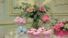 Amazing raspberry cake and flower bouquete decoration of the table. vintage Stock Footage