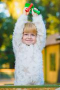 Happy little girl playing in sandbox at playground Stock Photos