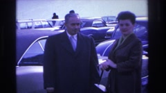 1966: two women and one man in parking lot posing for a picture HOBOKEN NEW Stock Footage