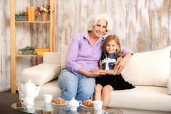 Friendly grandmother and grandchild entertaining together Stock Photos