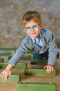 Young boy playing when having fun doing activities outdoors Stock Photos