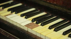 Feather closeup on piano keyboard. old piano Stock Footage