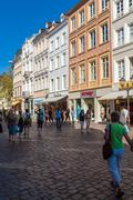 TRIER, GERMANY - APRIL 7, 2008:  Tourists walk along Simeon strasse Stock Photos