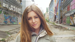 Young attractive female on ghetto street Stock Footage