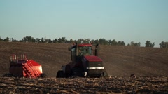 Tractor with by caterpillar has climbed up course Stock Footage
