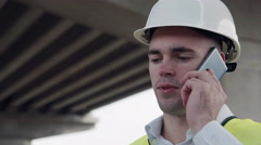 Foreman talking on mobile phone Stock Footage