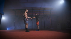 Two athletes doing difficult crossfit exercise at the same time Stock Footage