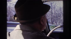 1966: man with hat driving car fast motion trees in background HOBOKEN  Stock Footage