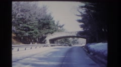 1966: car driving down the highway goes under a bridge HOBOKEN NEW JERSEY Stock Footage