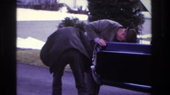 1966: two men are checking the problem of a car on the road HOBOKEN NEW JERSEY Stock Footage