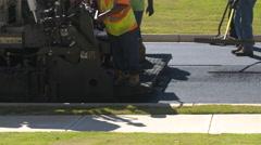 Medium Shot Road Workers Smooth Asphalt in Slow Motion Stock Footage