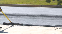 Asphalt Workers Clean Area for Pavement Stock Footage
