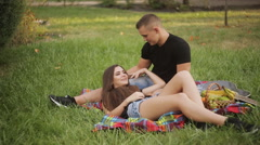 Beautiful Young Couple Having Picnic in Countryside. Happy Family Outdoor Stock Footage