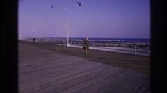 1966: vintage video of woman walking on boardwalk on a cool day HOBOKEN  Stock Footage