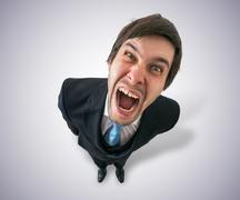 Young crazy businessman or boss is screaming. View from top. Stock Photos