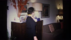1966: woman preparing for christmas party HOBOKEN NEW JERSEY Stock Footage