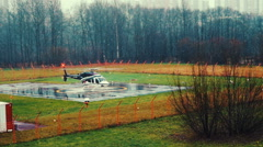 Helicopter Landing at Helipad Near Hospital Stock Footage