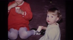 1966: cute kids indoor playing and posing for camera HOBOKEN NEW JERSEY Stock Footage