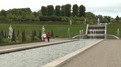 People walking in Landscaped Gardens at Frederiksborg Castle in Denmark Stock Footage