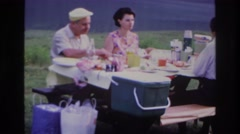 1967: people eating outdoor picnic talking OTTAWA CANADA Stock Footage