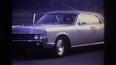 1967: several vehicles are parked at the side of the road  Stock Footage