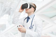 Indoors close up shot of doctor wearing virtual reality glasses Kuvituskuvat